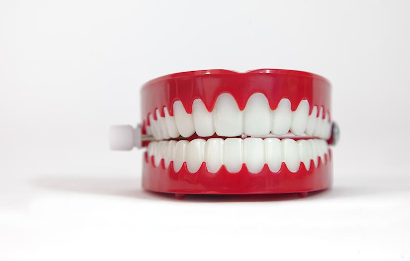 Front view of chattering novelty teeth. White background.