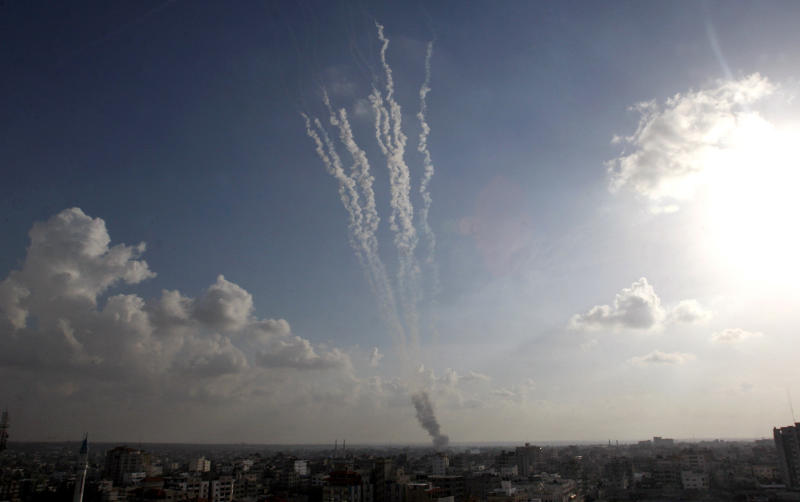 Smoke trails are seen after ordnance were fired by Palestinian militants from Gaza City towards southern Israel, Monday, Nov. 19, 2012. (AP Photo/Hatem Moussa)