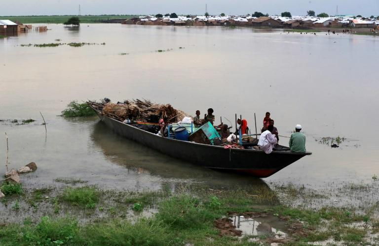 Heavy flooding has affected and displaced about 426,000 people in South Sudan, such as these pictured September 14, 2021, including 185,000 children, as overflowing rivers deluged homes and farms in the impoverished country (AFP/ASHRAF SHAZLY)