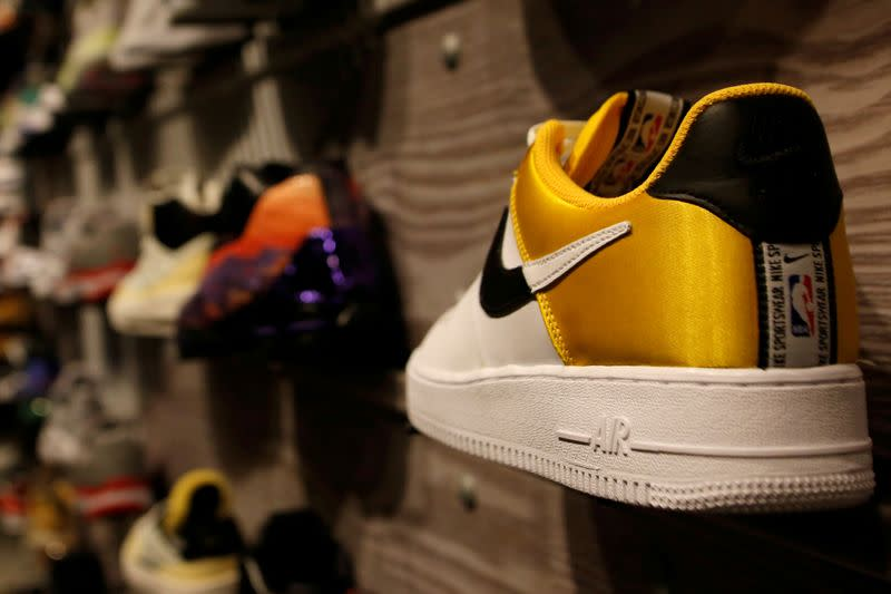 FILE PHOTO: A pair of Nike's Air Force shoes with a NBA logo are seen display at a Nike store in Beijing