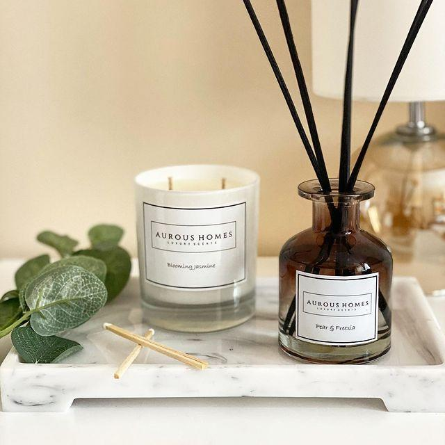 """<p>Founded in London in 2019, Aurous Homes create long lasting luxury scents for the home, through soy wax candles and fragrant diffusers - perfect for adding to any room in your home. Smells include Blooming Jasmine and Tropical Island.</p><p><a class=""""link rapid-noclick-resp"""" href=""""http://www.auroushomes.co.uk/"""" rel=""""nofollow noopener"""" target=""""_blank"""" data-ylk=""""slk:SHOP NOW"""">SHOP NOW</a><br></p><p><strong>Like this article? <a href=""""https://hearst.emsecure.net/optiext/optiextension.dll?ID=nPTl681bgeiKhoMTpW31pzPluR1KbK8iYdv56%2BzY5rdcCoNqPYqUsTx_%2BXEjZKPdzGeMe03lZk%2B1nA"""" rel=""""nofollow noopener"""" target=""""_blank"""" data-ylk=""""slk:Sign up to our newsletter"""" class=""""link rapid-noclick-resp"""">Sign up to our newsletter</a> to get more articles like this delivered straight to your inbox.</strong></p><p><a class=""""link rapid-noclick-resp"""" href=""""https://hearst.emsecure.net/optiext/cr.aspx?ID=XWcX9nJNKD5cwayLSvHaiX8%2BrTbeG%2B2ITl5Cggu1nIJkSdR7dtz4UJ3HsqKHRhpCTSFrDuvbdNAgXr"""" rel=""""nofollow noopener"""" target=""""_blank"""" data-ylk=""""slk:SIGN UP""""><strong>SIGN UP</strong></a></p><p><a href=""""https://www.instagram.com/p/CC0ef_lJY3-/?utm_source=ig_embed&utm_campaign=loading"""" rel=""""nofollow noopener"""" target=""""_blank"""" data-ylk=""""slk:See the original post on Instagram"""" class=""""link rapid-noclick-resp"""">See the original post on Instagram</a></p>"""