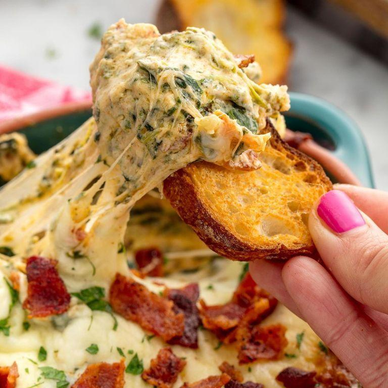 "<p>This is our favorite way to get in some greens on game day.</p><p><em><a href=""https://www.delish.com/cooking/recipe-ideas/recipes/a50161/bacon-spinach-dip-recipe/"" rel=""nofollow noopener"" target=""_blank"" data-ylk=""slk:Get the recipe from Delish »"" class=""link rapid-noclick-resp"">Get the recipe from Delish »</a></em></p><p><strong>RELATED: </strong><a href=""https://www.goodhousekeeping.com/food-recipes/party-ideas/g477/football-superbowl-snacks/"" rel=""nofollow noopener"" target=""_blank"" data-ylk=""slk:46 So-Good Super Bowl Snacks for Football's Biggest Day of the Year"" class=""link rapid-noclick-resp"">46 So-Good Super Bowl Snacks for Football's Biggest Day of the Year</a></p>"