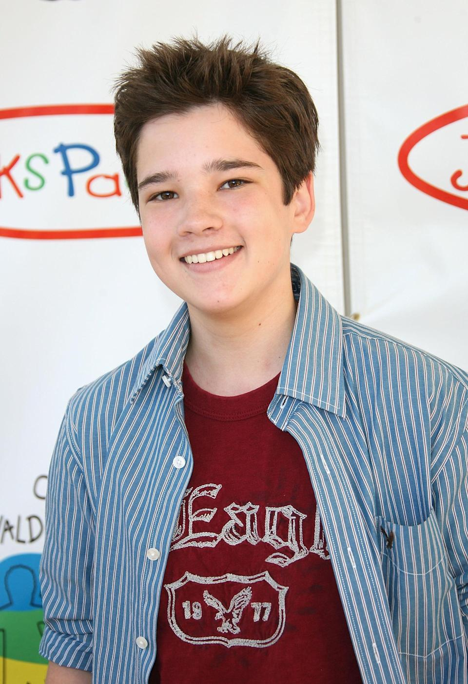 <p>Nathan Kress was 14 years old when <strong>iCarly</strong> debuted on television, making him roughly six months older than his costar Miranda Cosgrove. His role as Freddie Benson was the actor's first major television gig, though he did play an extra in one episode of <strong>Drake &amp; Josh</strong> in 2007.</p>