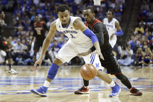 Louisville's Russ Smith, right, slaps the ball away from Memphis' Chris Crawford (3) in the first half of an NCAA college basketball game in Memphis, Tenn., Saturday, March 1, 2014. (AP Photo/Danny Johnston)