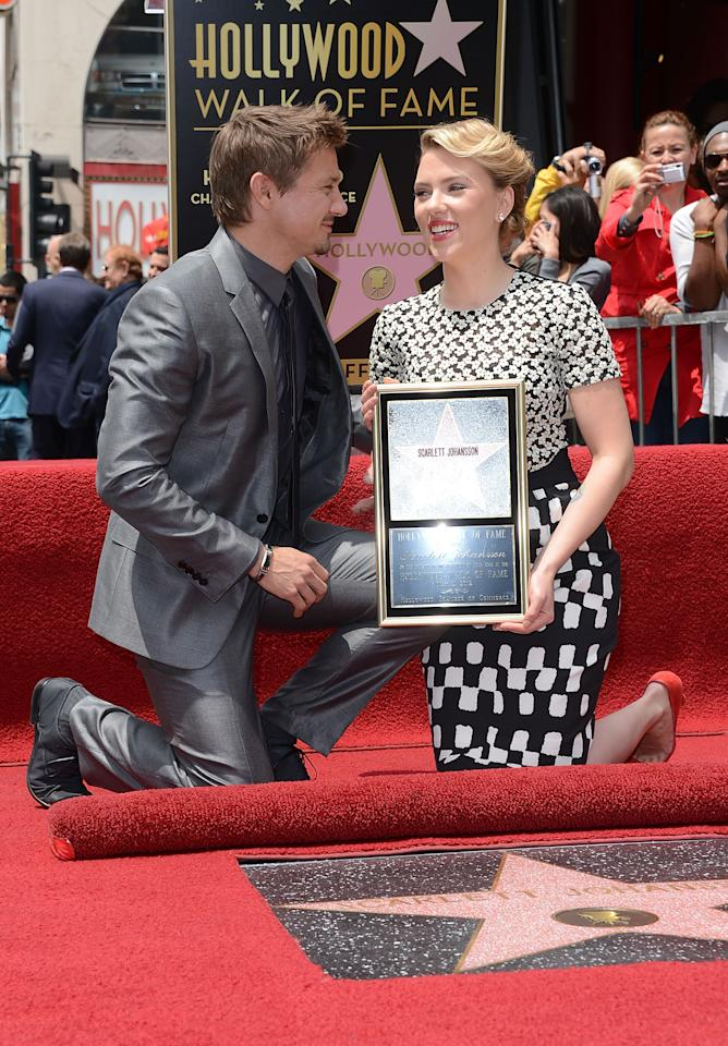 HOLLYWOOD, CA - MAY 02:  Actress Scarlett Johansson and actor Jeremy Renner pose as Scarlett Johansson  is honored with a star on The Hollywood Walk Of Fame on May 2, 2012 in Hollywood, California.  (Photo by Jason Merritt/Getty Images)