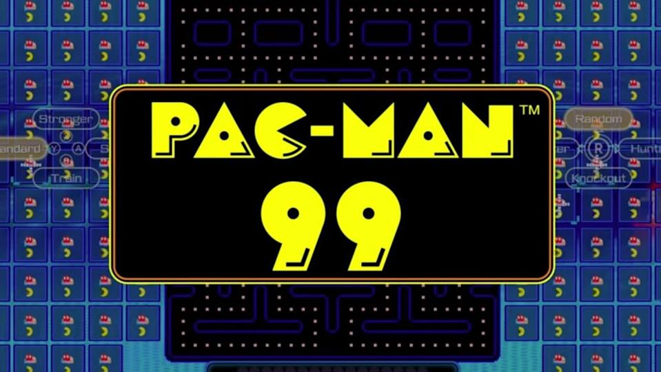 A photo of the title screen of Pac Man 99 with the title in bright yellow against a black and blue backdrop