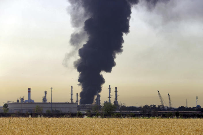 A dark plume of smoke rises up from a main oil refinery south of Tehran, Iran, Thursday, June 3, 2021. A massive fire broke out Wednesday night at the oil refinery serving Iran's capital, sending thick plumes of black smoke over Tehran. (AP Photo/Ebrahim Noroozi)