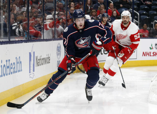 Columbus Blue Jackets forward Josh Anderson, left, controls the puck in front of Detroit Red Wings defenseman Jonathan Ericsson, of Sweden, during the second period of an NHL hockey game in Columbus, Ohio, Thursday, Nov. 21, 2019. (AP Photo/Paul Vernon)