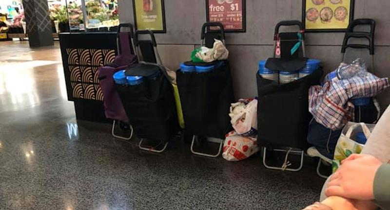 Matt Ward claims he witnessed 10 people stockpile about 100 tins of baby formula from a Melbourne Woolworths. Pictured are five trolleys, some seen holding several tins of formula.