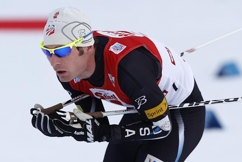 Bryan Fletcher of the US ski to finish fifth in the Nordic Combined triple World Cup in Seefeld, Austria, Sunday, Jan.19, 2014