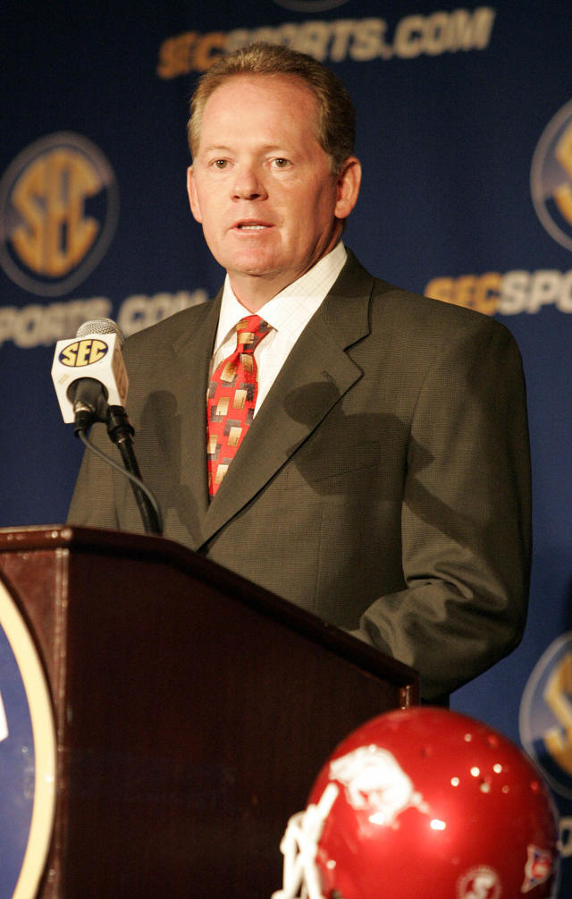 This July 22, 2009 file photo shows Arkansas football coach Bobby Petrino speaking to the media during a news conference at the SEC Media Days in Hoover, Ala. A person familiar with the situation says Petrino is out as the football coach at Arkansas. The person spoke to The Associated Press on the condition of anonymity, and the university has scheduled a Tuesday April 10, 2012 news conference with athletic director Jeff Long. (AP Photo/ Butch Dill,File)