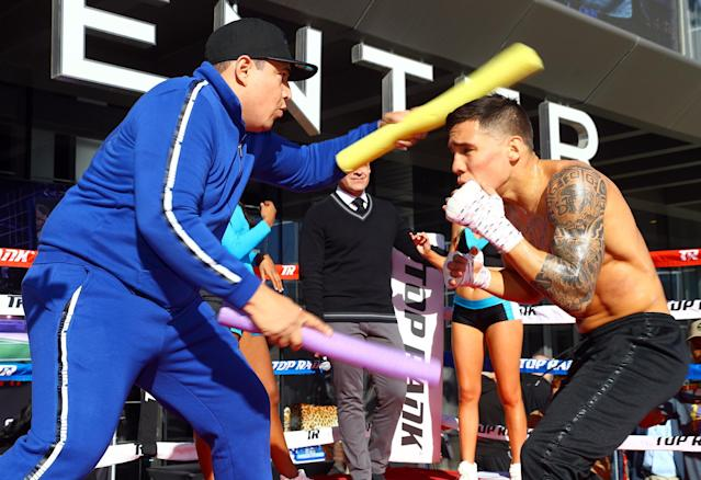 Oscar Valdez (R) hired Eddy Reynoso (L), Canelo Alvarez's long-time trainer, to improve his approach. (Mikey Williams/Top Rank)