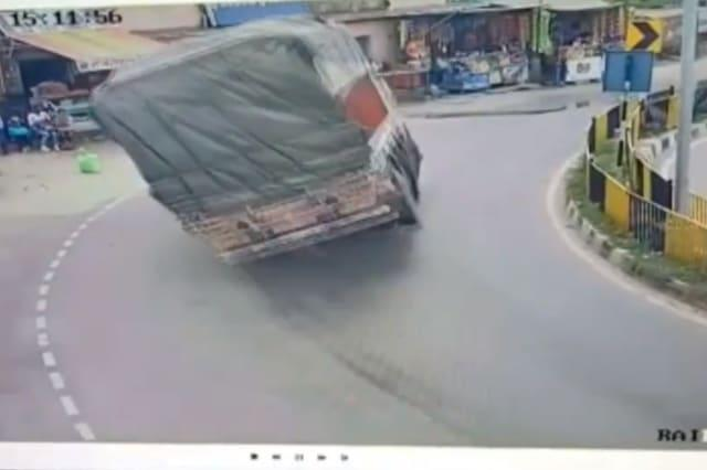 Two speeding trucks topple at the same spot in Indian city after residents plea for speed bump is ignored