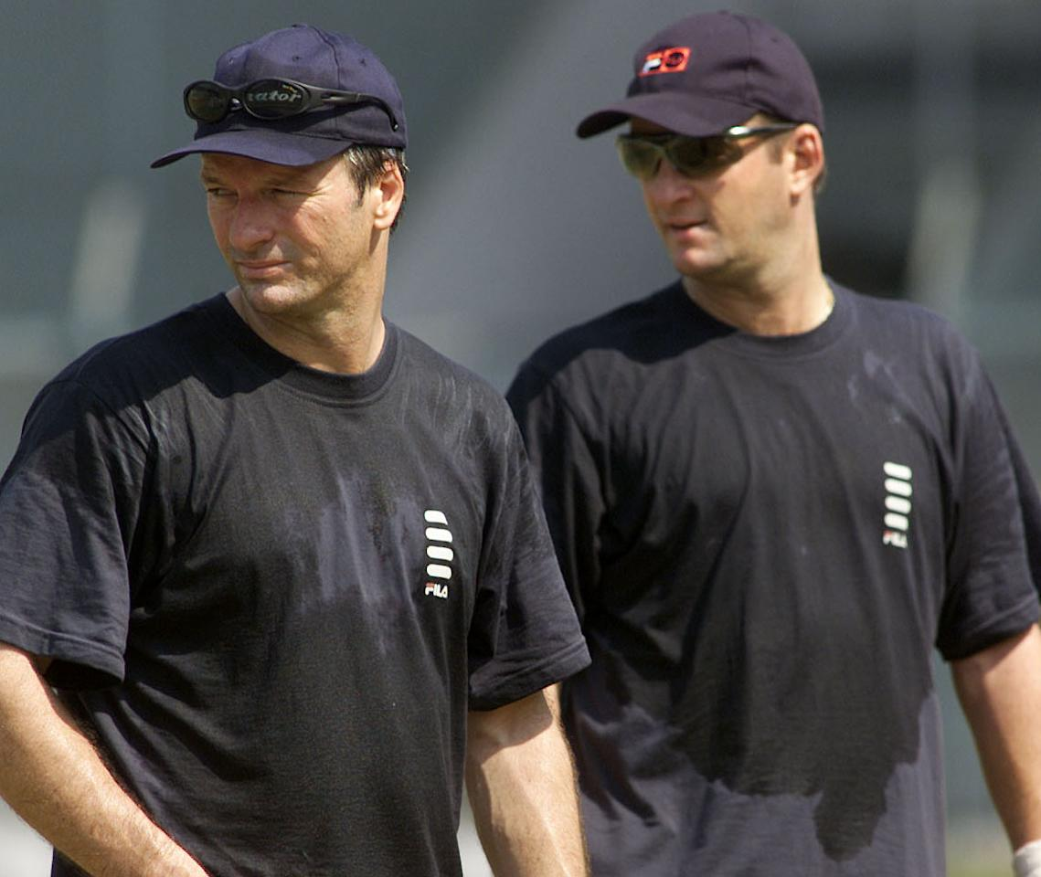 21 Feb 2001:  Steve (left) and Mark Waugh of Australia look on, during training at the Cricket Club of India, Mumbai, India. X DIGITAL IMAGE  Mandatory Credit: Hamish Blair/ALLSPORT