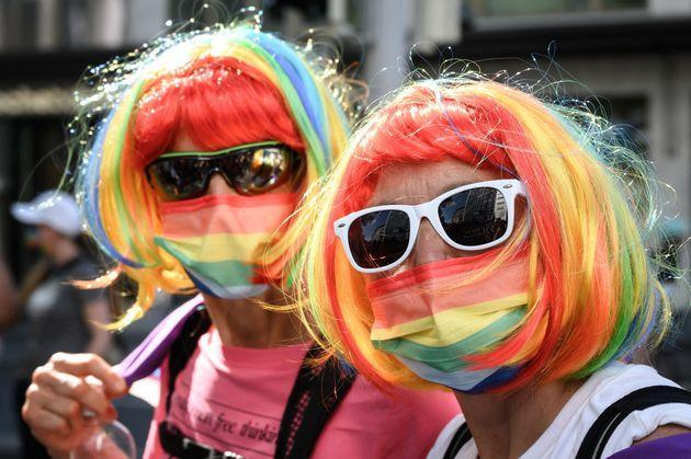 LGBTQ community members and allies take part in the Zurich Pride on Sept. 4. (Photo: FABRICE COFFRINI via Getty Images)