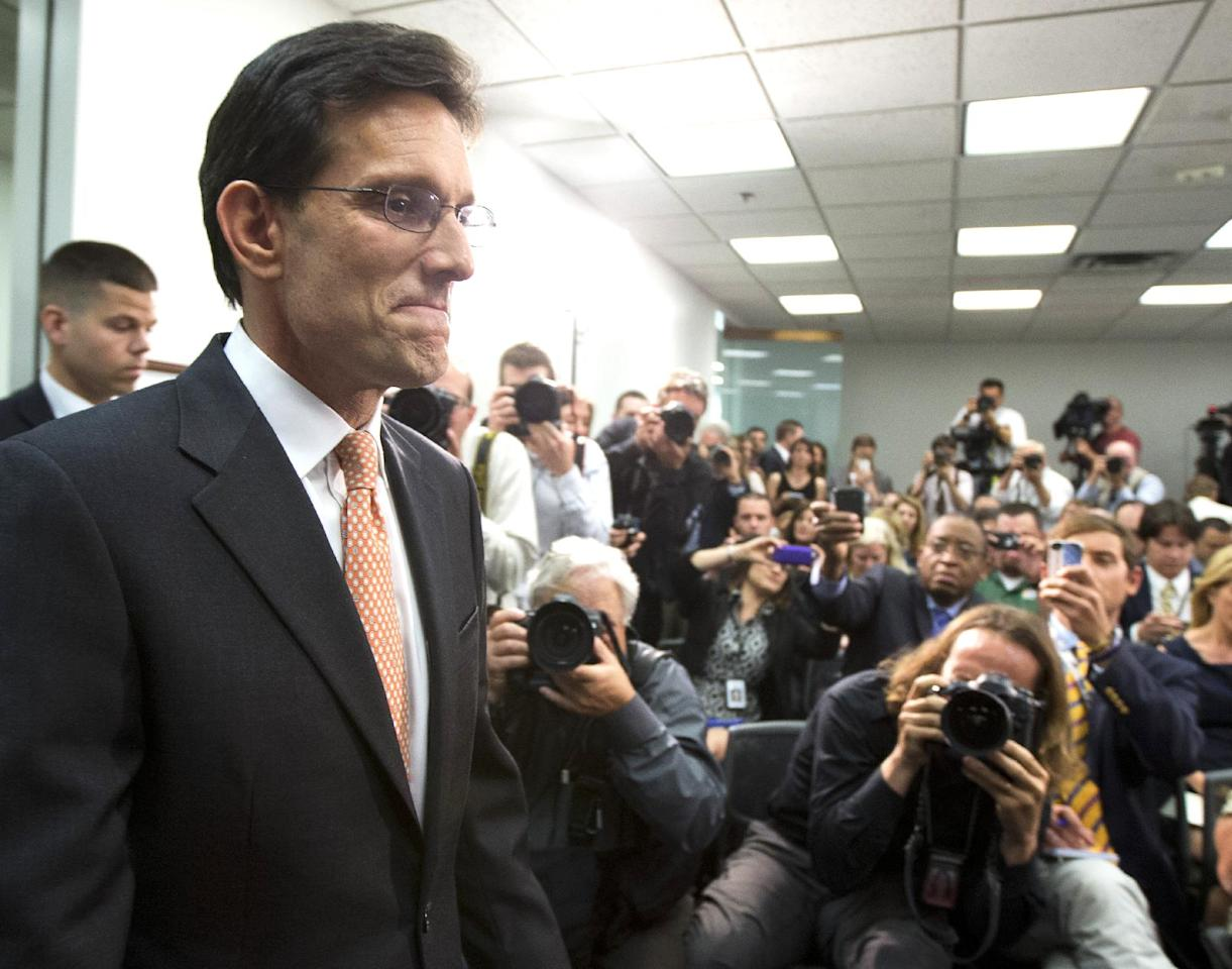 House Majority Leader Eric Cantor of Virginia, arrives for news conference on Capitol Hill in Washington, Wednesday, June 11, 2014. Repudiated at the polls, Cantor intends to resign his leadership post at the end of next month, officials said, clearing the way for a potentially disruptive Republican shake-up just before midterm elections with control of Congress at stake. (AP Photo/Manuel Balce Ceneta)