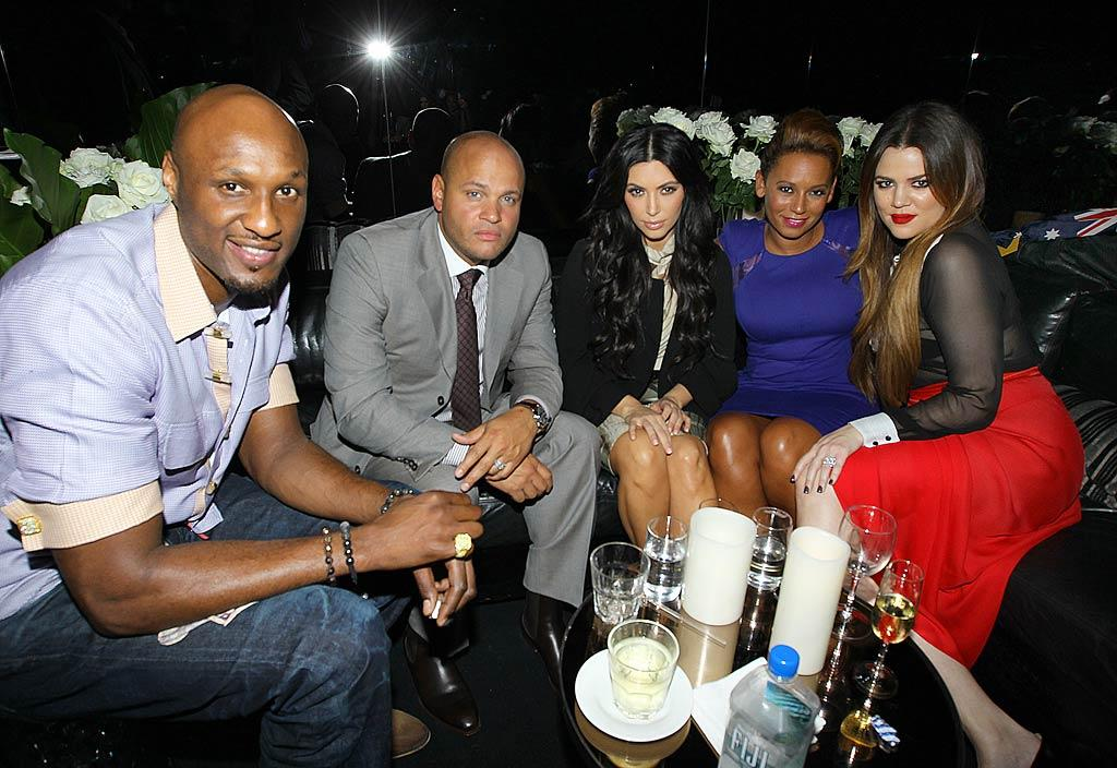 The unlucky-in-love Kim Kardashian looked somber as she was surrounded by happy couples -- Mel B and hubby Stephern Belafonte and Kim's sister Khloe and brother-in-law Lamar Odom -- at an event in Sydney, Australia, on Wednesday. Just two days before, the reality star announced she was filing for divorce from NBA player Kris Humphries, her husband of just 72 days. (11/2/2011)