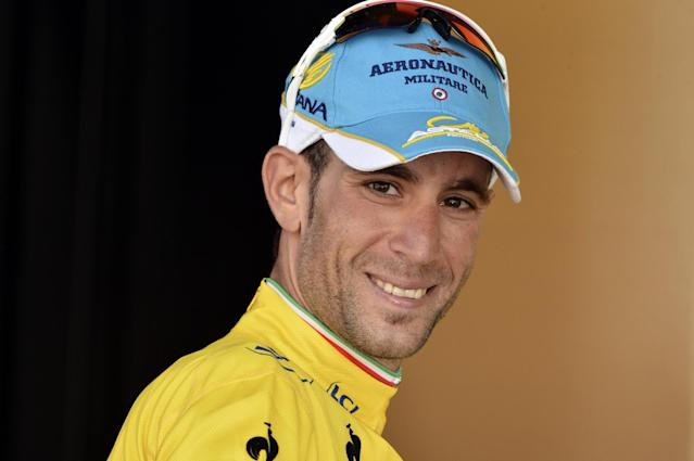 Italian Vincenzo Nibali celebrates after winning stage 13 of the Tour de France on Friday 18 July 2014 (AFP Photo/Jeff Pachoud)