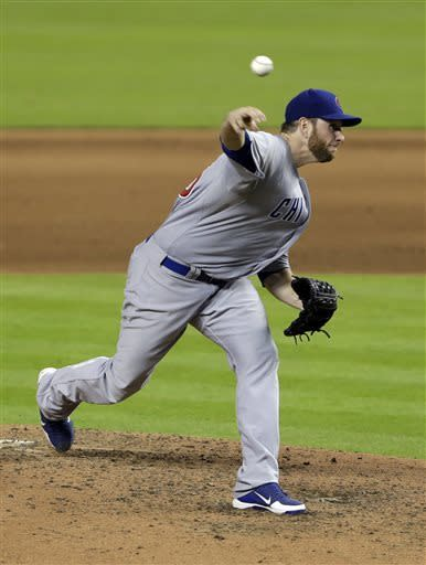 Chicago Cubs' Scott Feldman delivers a pitch during the sixth inning of a baseball game against the Miami Marlins, Friday, April 26, 2013 in Miami. (AP Photo/Wilfredo Lee)