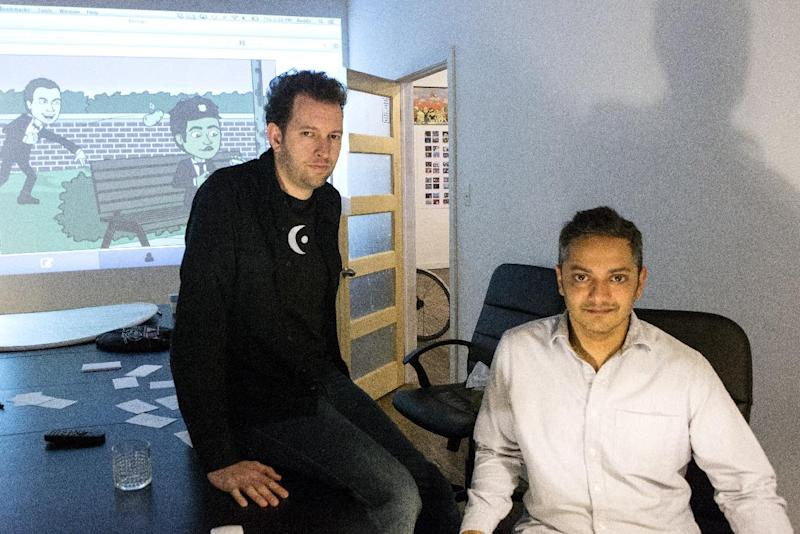 In this Dec. 19, 2013 photo, Bitstrips CEO and Creative Director Jacob Blackstock, left, and co-founder Shahan Panth pose for a photo at the company's offices in Toronto. Bitstrips, a mobile application that helps people turn their lives into comic strips, may seem like a sudden sensation now that its vignettes are all over Facebook and other social networks. But the Toronto startup's success has been a drawn-out process. (AP Photo/The Canadian Press, Chris Young)