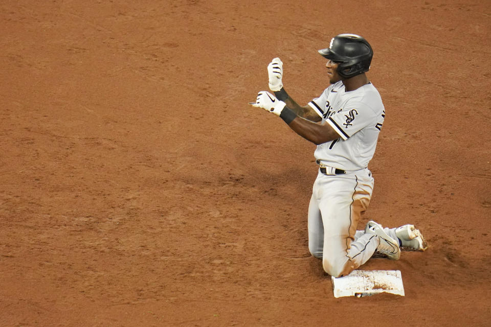 Chicago White Sox's Tim Anderson reacts after hitting a two-run double against the Baltimore Orioles during the sixth inning of a baseball game, Friday, July 9, 2021, in Baltimore. White Sox's Andrew Vaughn and Gavin Sheets scored on the double. (AP Photo/Julio Cortez)