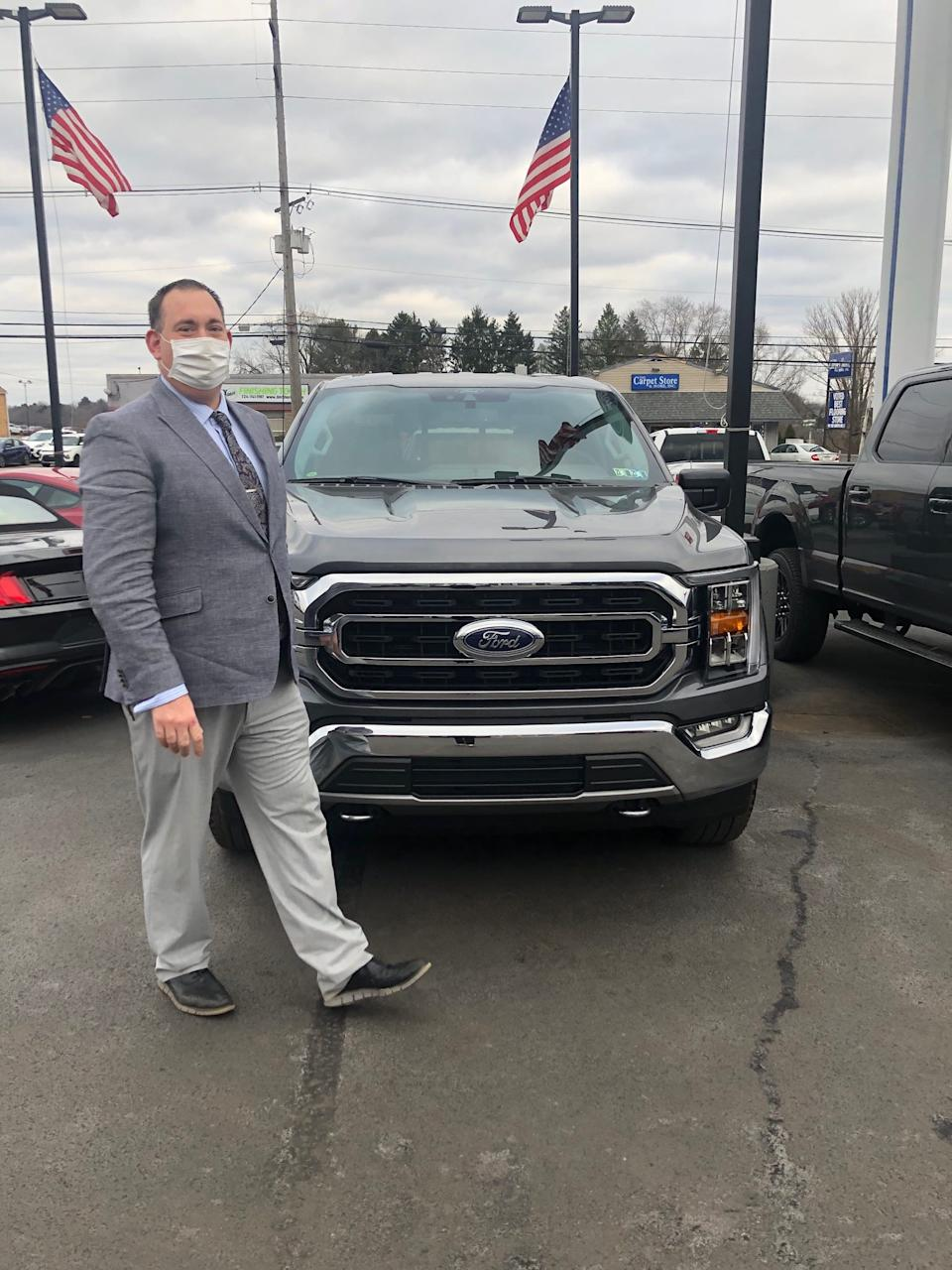 John Huselton, general sales manager at Shults Ford in Wexford, Pennsylvania is walking past a 2021 Ford F-150 on Tues., December 8, 2020. He has 300 on order and he has received eight.