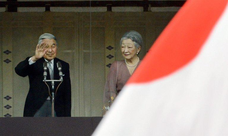 Japanese Emperor Akihito (L) and Empress Michiko greet the crowds on his 79th birthday at the Imperial Palace in Tokyo on December 23, 2012. He reassured thousands of well-wishers that he has regained health since his heart bypass surgery in February