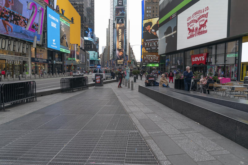 NEW YORK, UNITED STATES - 2020/03/18: Times Square is sparsely populated due to ongoing coronavirus cases and fears. (Photo by Lev Radin/Pacific Press/LightRocket via Getty Images)