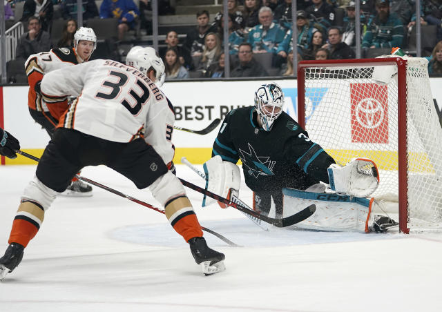 San Jose Sharks goaltender Martin Jones (31) makes a glove save on a shot by Anaheim Ducks right wing Jakob Silfverberg (33) during the second period of an NHL hockey game in San Jose, Calif., Thursday, Dec. 27, 2018. (AP Photo/Tony Avelar)