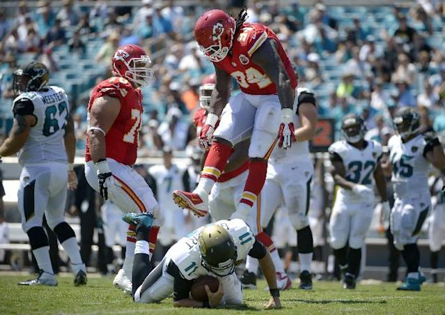FILE - In this Sept. 8, 2013, file photo, Kansas City Chiefs defensive end Tyson Jackson (94) celebrates after sacking Jacksonville Jaguars quarterback Blaine Gabbert (11) as defensive end Mike DeVito (70) joins during an NFL football game in Jacksonville, Fla. Jacksonville has lost its first seven games by an average of nearly 21 points. (AP Photo/Phelan M. Ebenhack, File)