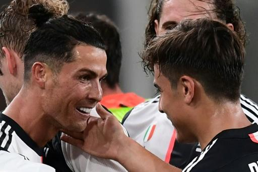 Paulo Dybala and Cristiano Ronaldo sent Juventus on their way with goals in a 3-1 win at Genoa