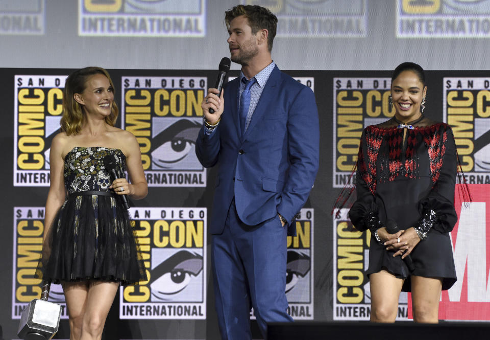 """Natalie Portman, from left, Chris Hemsworth and Tessa Thompson participate during the """"Thor Love And Thunder"""" portion of the Marvel Studios panel on day three of Comic-Con International on Saturday, July 20, 2019, in San Diego. (Photo by Chris Pizzello/Invision/AP)"""