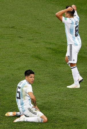Soccer Football - World Cup - Group D - Argentina vs Croatia - Nizhny Novgorod Stadium, Nizhny Novgorod, Russia - June 21, 2018 Argentina's Enzo Perez and Marcos Acuna react REUTERS/Carlos Barria