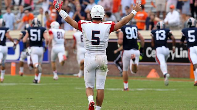 Richmond quarterback Kyle Lauletta (5) celebrates a touchdown during the second half of an NCAA football game against Virginia, Saturday Sept. 3, 2016, in Charlottesville, Va. Richmond defeated Virginia 37-20. (AP Photo/Andrew Shurtleff)