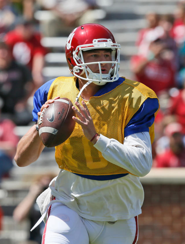 FILE - In this April 8, 2017, file photo, Oklahoma quarterback Austin Kendall looks for a receiver during the annual Oklahoma NCAA college spring football game in Norman, Okla. For Lincoln Rileys second season as head coach at Oklahoma, the Sooners have to find Heisman winner Baker Mayfields successor. So a big part of the coachs first spring was determining the new starter, a process between last years backup Kyler Murray and redshirt Austin Kendall that continue into the summer and preseason. (AP Photo/Sue Ogrocki, File)
