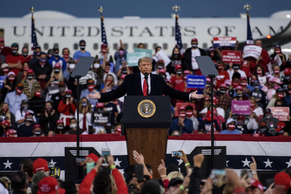 FAYETTEVILLE, NC - SEPTEMBER 19: President Donald Trump addresses a crowd at the Fayetteville Regional Airport on September 19, 2020 in Fayetteville, North Carolina. Thousands of people joined to hear the president during the Make America Great Again campaign rally. (Photo by Melissa Sue Gerrits/Getty Images)