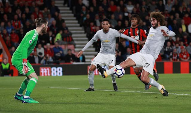 "Soccer Football - Premier League - AFC Bournemouth vs Manchester United - Vitality Stadium, Bournemouth, Britain - April 18, 2018 Manchester United's Marouane Fellaini clears as David De Gea looks on REUTERS/Ian Walton EDITORIAL USE ONLY. No use with unauthorized audio, video, data, fixture lists, club/league logos or ""live"" services. Online in-match use limited to 75 images, no video emulation. No use in betting, games or single club/league/player publications. Please contact your account representative for further details."