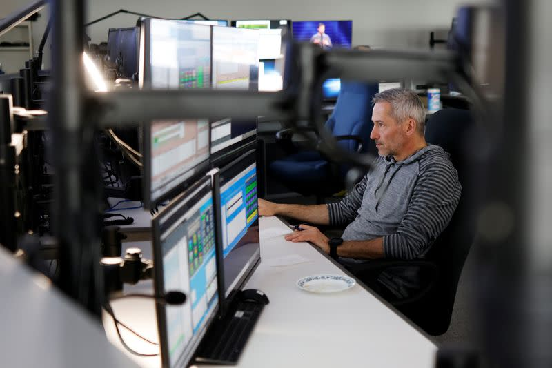 Lead satellite controller Michael Arsenault works at the offices of Telesat in Ottawa
