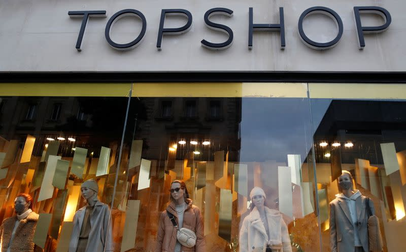 Manequins are seen in the window of a Topshop store in Liverpool, Britain