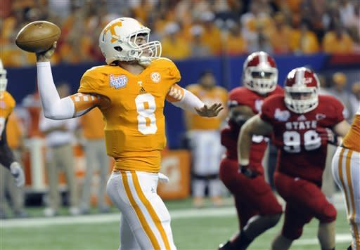 Tennessee quarterback Tyler Bray (8) passes as North Carolina State defensive end McKay Frandsen (98) defends during the second quarter of the Chick-fil-A Kickoff Game, during an NCAA college football game in Atlanta., on Friday, Aug. 31, 2012. (AP Photo/John Amis)