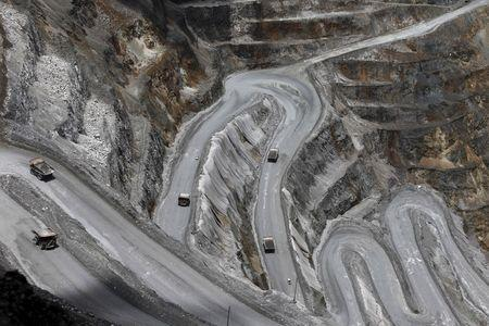 FILE PHOTO: Trucks operate in the open-pit mine of PT Freeport's Grasberg copper and gold mine complex near Timika, in the eastern region of Papua, Indonesia on September 19, 2015 in this photo taken by Antara Foto.   REUTERS/Muhammad Adimaja/Antara Foto/File Photo