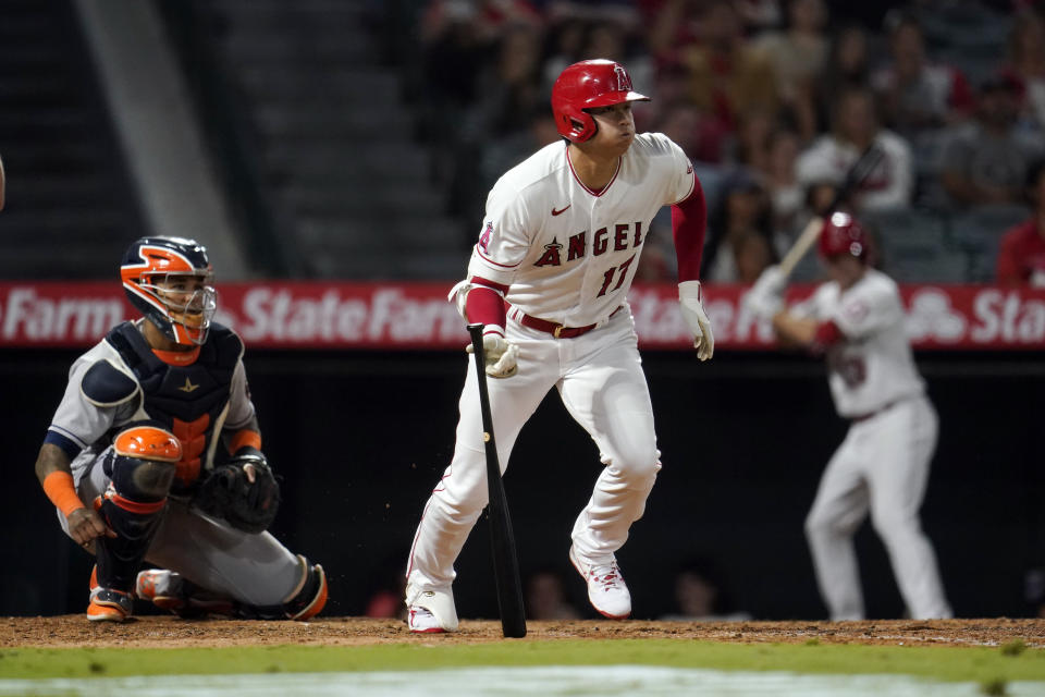 Los Angeles Angels' Shohei Ohtani follows through on a single during the sixth inning of a baseball game against the Houston Astros Tuesday, Sept. 21, 2021, in Anaheim, Calif. (AP Photo/Marcio Jose Sanchez)