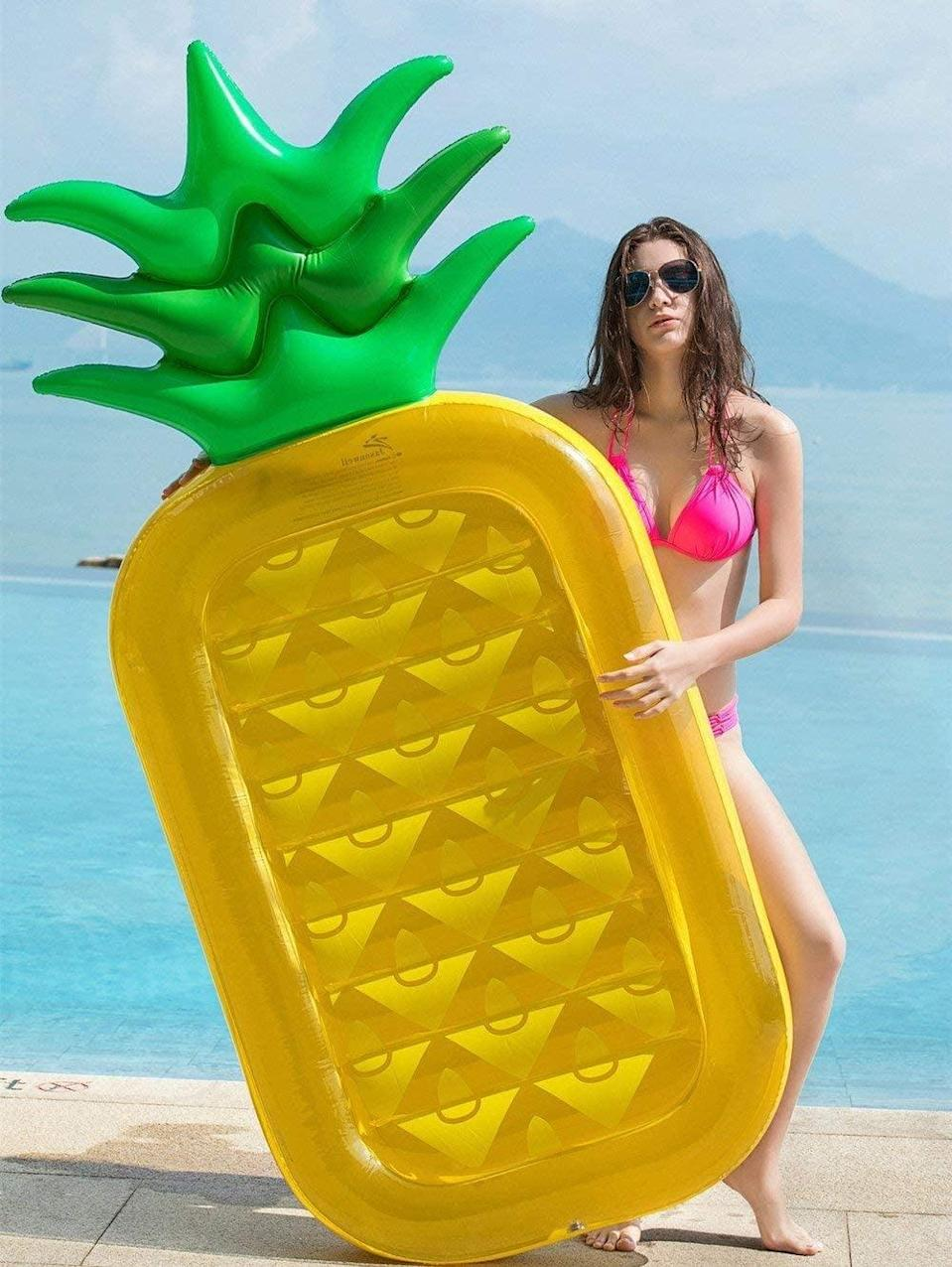 """<p>The only thing that goes with the <span>Jasonwell Giant 76"""" Pineapple Pool Float</span> ($26) is a piña colada.</p>"""