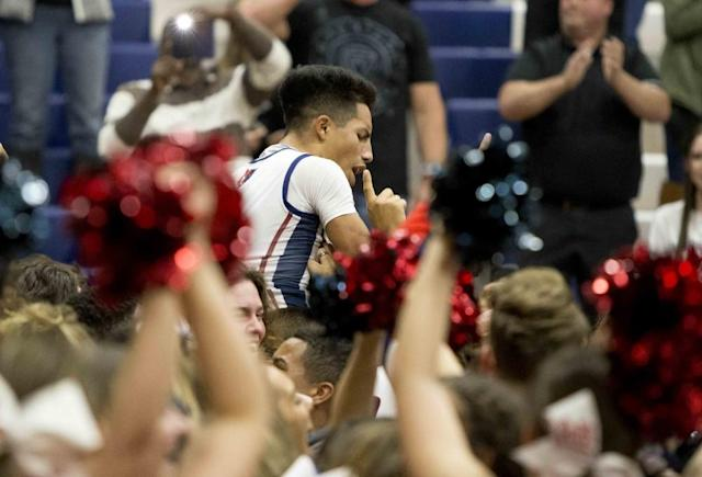 Jojo Rincon gets carried off the court after knocking down a game-winning shot from halfcourt. (via Jacob Stanek/West Valley Preps)