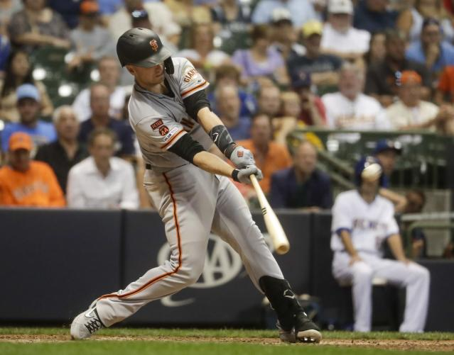 San Francisco Giants' Buster Posey hits a grand slam during the 10th inning of a baseball game against the Milwaukee Brewers Friday, July 12, 2019, in Milwaukee. (AP Photo/Morry Gash)