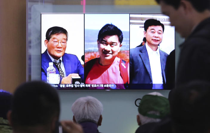 At the Seoul Railway Station on May 3, South Koreans watch a TV news report showing portraits of three Americans, from left, Kim Dong Chul, left, Tony Kim and Kim Hak Song, detained in North Korea. (Photo: Ahn Young-joon/AP)