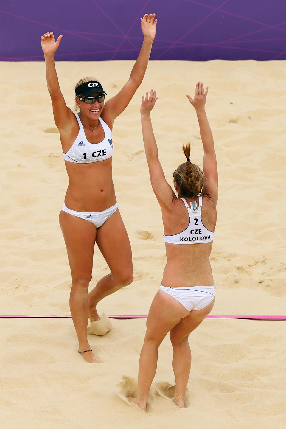 LONDON, ENGLAND - JULY 28: Kristyna Kolocova and Marketa Slukova of Czech Republic celebrate their victory after the Women's Beach Volleyball Preliminary Round against Austria on Day 1 of the London 2012 Olympic Games at Horse Guards Parade on July 28, 2012 in London, England. (Photo by Ryan Pierse/Getty Images)