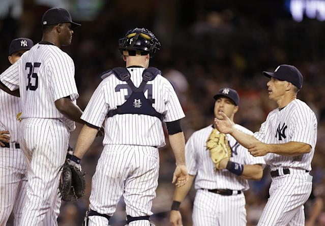 New York Yankees manager Joe Girardi, right, takes starting pitcher Michael Pineda (35) out of the game during the seventh inning of a baseball game Wednesday, Aug. 20, 2014, in New York. (AP Photo/Frank Franklin II)