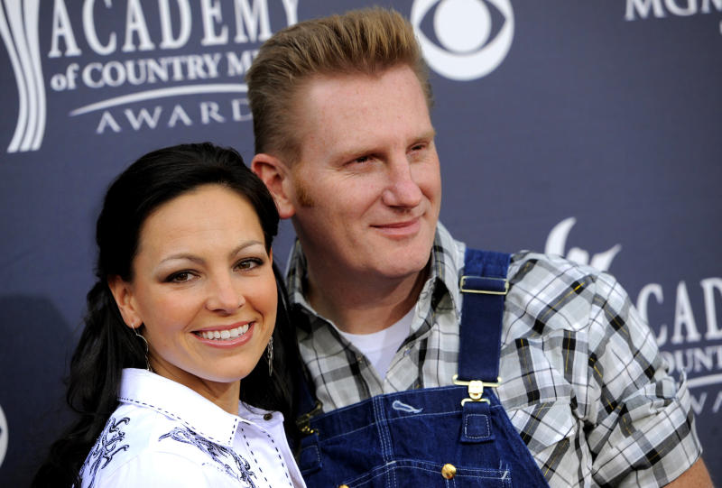 """FILE - In this April 3, 2011, file photo, Joey  Feek, left, and husband Rory  Feek, of """"Joey + Rory,"""" arrive at the Annual Academy of Country Music Awards in Las Vegas. Rory Feek paid tribute to Joey with a series of Instagram posts on March 4, 2017, to mark one year since her death. (AP Photo/Chris Pizzello, File)"""