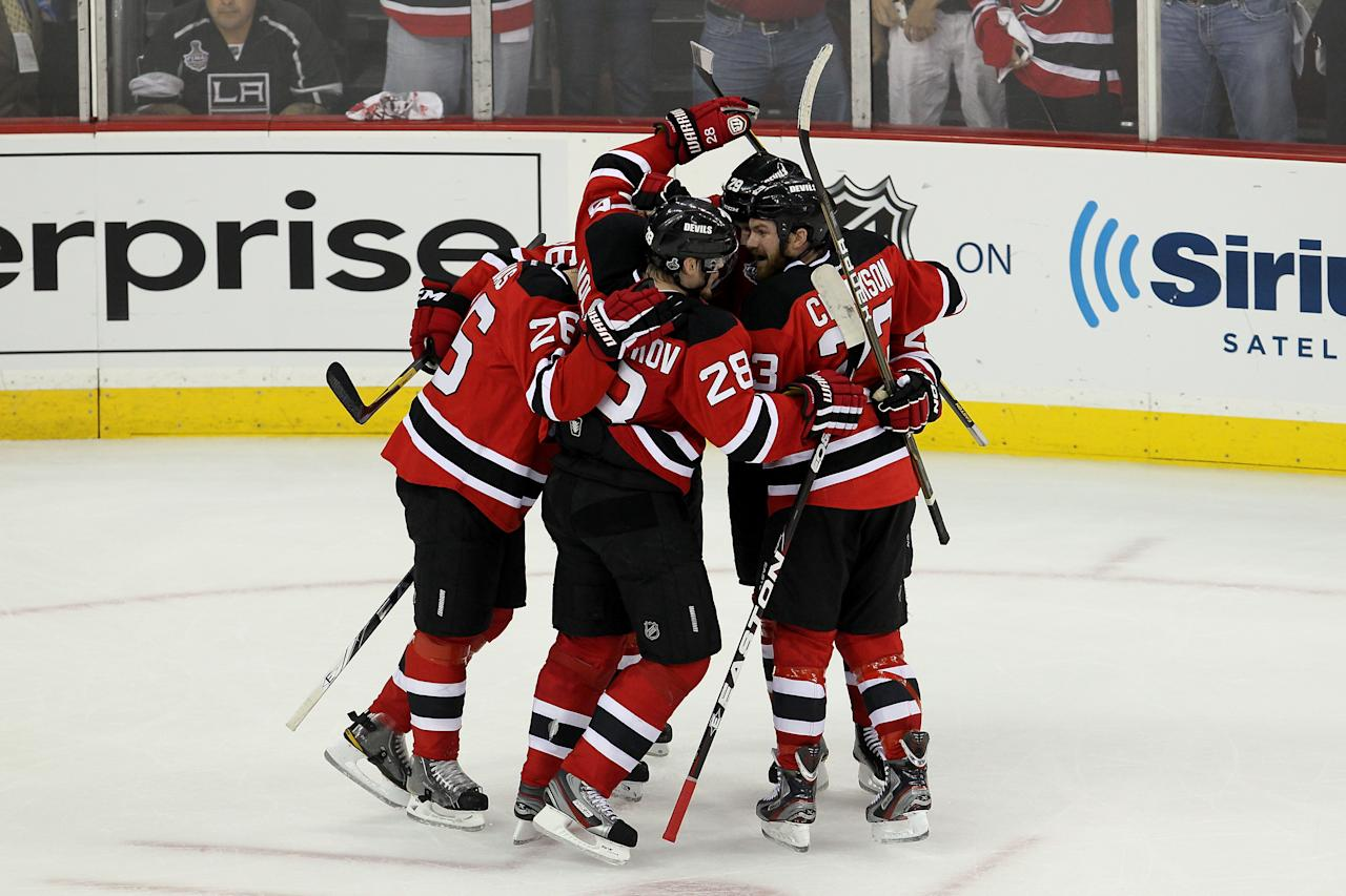 NEWARK, NJ - MAY 30: Anton Volchenkov #28 of the New Jersey Devils celebrates with teammates after scoring a goal in the second period against the Los Angeles Kings during Game One of the 2012 NHL Stanley Cup Final at the Prudential Center on May 30, 2012 in Newark, New Jersey.  (Photo by Jim McIsaac/Getty Images)